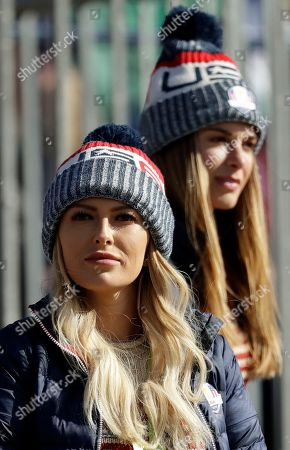 Stock Photo of Paulina Gretzky, the partner of Dustin Johnson of the US and Jena Sims, right, the partner of Brooks Koepka of the US watch them play in a foursome match on the second day of the 42nd Ryder Cup at Le Golf National in Saint-Quentin-en-Yvelines, outside Paris, France
