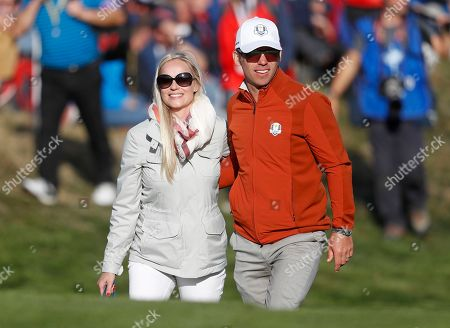 Europe's Paul Casey and his wife Pollyanna Woodward watch a foursome match on the second day of the 42nd Ryder Cup at Le Golf National in Saint-Quentin-en-Yvelines, outside Paris, France
