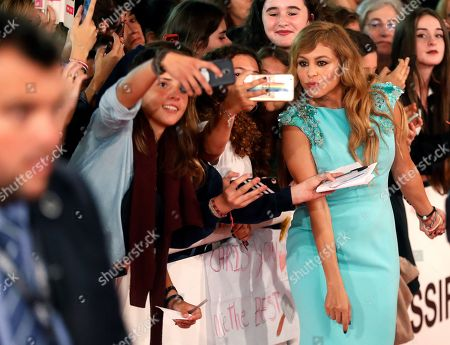 Mexican singer Paulina Rubio poses for a selfie picture with fans as she arrives at the closing ceremony of the 66th San Sebastian International Film Festival, in San Sebastian, Spain, 29 September 2018. The 66th edition of the SSIFF runs from 21 to 29 September.