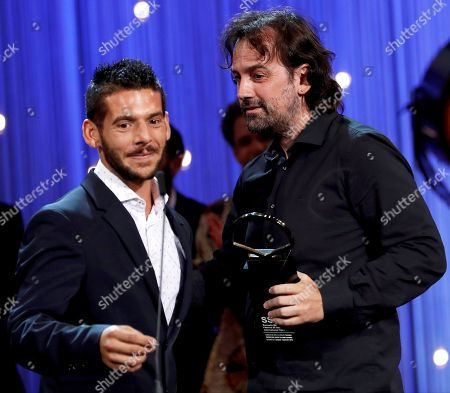 Spanish Director Isaki Lacuesta (R) receives the Concha de Oro Award for the best film from Spanish actor Israel Gomez (L) during the closing ceremony of the 66th San Sebastian International Film Festival, in San Sebastian, Spain, 29 September 2018. The 66th edition of the SSIFF runs from 21 to 29 September.
