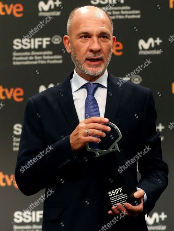 Stock Photo of Argentine Actor Dario Grandinetti poses after receiving the Silver Shell to Best Actor during the 66 San Sebastian International Film Festival closing gala, in San Sebastian, Spain, 29 September 2018.