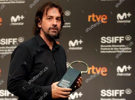 Spanish Director Isaki Lacuesta after receiving the Silver Shell to Best Movie for 'Entre dos aguas' during the 66 San Sebastian International Film Festival closing gala, in San Sebastian, Spain, 29 September 2018.
