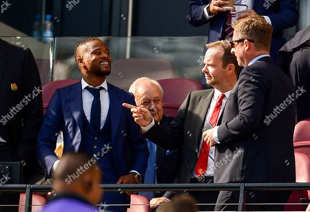 Patrice Evra and Ed Woodward Chief Executive of Manchester United in the directors box