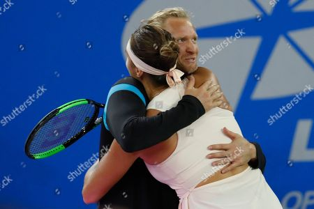 Aryna Sabalenka (R) of Belarus celebrates with her coach Dmitry Tursunov after her final singles match against Anett Kontaveit of Estonia at the 2018 WTA Wuhan Open tennis tournament in Wuhan, China, 29 September 2018.