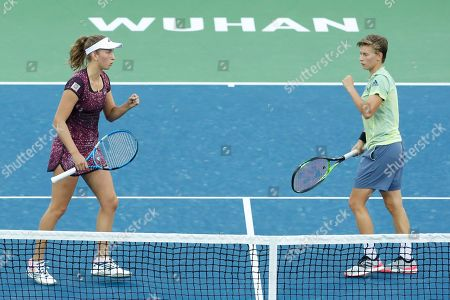 Demi Schuurs of The Netherlands (R) and Elise Mertens of Belgium (L) react during their doubles final match against Czech Republic's Barbora Strycova and Andrea Sestini Hlavackova at the 2018 WTA Wuhan Open tennis tournament in Wuhan, China, 29 September 2018.