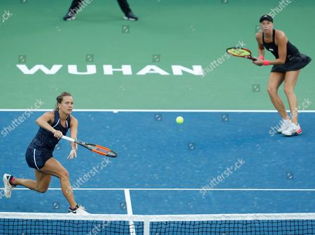 Czech Republic's Barbora Strycova (L) and Andrea Sestini  Hlavackova in action during their doubles final match against  Demi Schuurs of The Netherlands and Elise Mertens of Belgium at the 2018 WTA Wuhan Open tennis tournament in Wuhan, China, 29 September 2018.