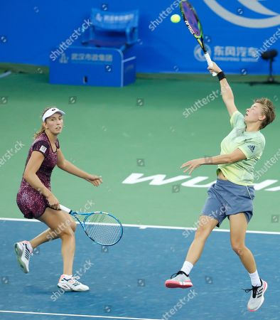 Demi Schuurs of The Netherlands (R) and Elise Mertens of Belgium (L) in action during their doubles final match against Czech Republic's Barbora Strycova and Andrea Sestini Hlavackova at the 2018 WTA Wuhan Open tennis tournament in Wuhan, China, 29 September 2018.