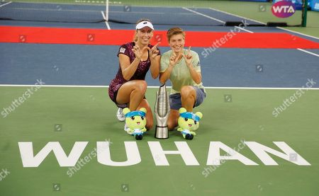 Demi Schuurs of The Netherlands (R) and Elise Mertens of Belgium celebrate with the trophy after winning their doubles final match against Czech Republic's Barbora Strycova and Andrea Sestini Hlavackova at the 2018 WTA Wuhan Open tennis tournament in Wuhan, China, 29 September 2018.