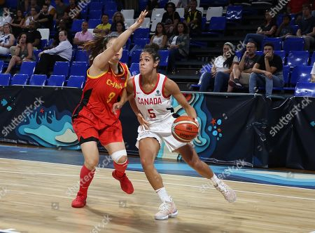 Canadian player Kia Nurse (R) vies for the ball with Chinese player Meng Li during the classification match between Canada and China at the 2018 FIBA Women's Basketball World Cup in San Cristobal de La Laguna, Canary Islands, Spain, 29 September 2018.