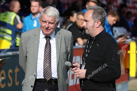 John Motson OBE about to be interviewed during the EFL Sky Bet League 1 match between AFC Wimbledon and Oxford United at the Cherry Red Records Stadium, Kingston
