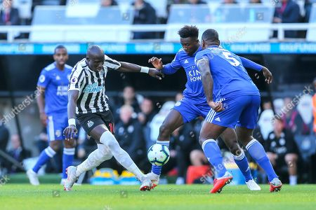 Stock Photo of Mohamed Diam? (#10) of Newcastle United is dispossessed by Wes Morgan (#5) of Leicester City during the Premier League match between Newcastle United and Leicester City at St. James's Park, Newcastle