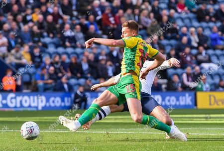 Harvey Barnes of West Bromwich Albion brings a save from Goalkeeper Chris Maxwell of Preston North End as Paul Huntington of Preston North End tackles