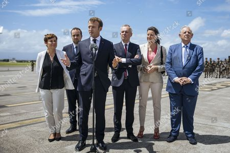 French President Emmanuel Macron (2nd L) speaks after arriving with (from L) Overseas Minister Annick Girardin, Minister for the Ecological and Inclusive Transition Francois de Rugy, Minister for Solidarity and Health Agnes Buzyn and Minister for the Territorial Cohesion Jacques Mezard as part of a four-day visit to the French Antilles (west indies), Guadeloupe,