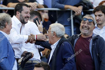 Matteo Salvini (L), Italian Interior minister and Italian actor Claudio Amendola (R) during the Italian Serie A soccer match between AS Roma and SS Lazio at Olimpico stadium in Rome, Italy, 29 September 2018.