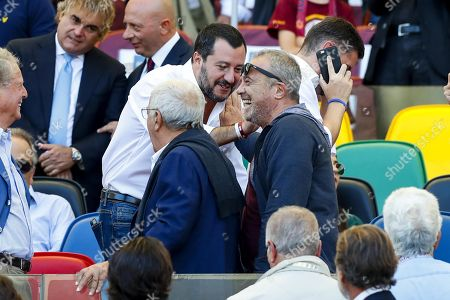 Matteo Salvini (C-L), Italian Interior minister and Italian actor Claudio Amendola (C-R) during the Italian Serie A soccer match between AS Roma and SS Lazio at Olimpico stadium in Rome, Italy, 29 September 2018.