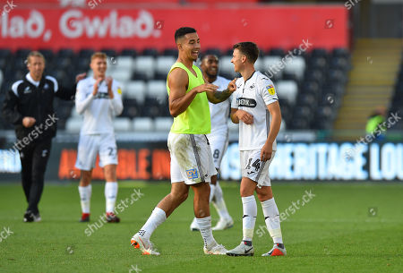 Goalscorer Courtney Baker-Richardson (46) of Swansea City celebrates with Tom Carroll (14) of Swansea City at full time after Swansea beat QPR 3-0 during the EFL Sky Bet Championship match between Swansea City and Queens Park Rangers at the Liberty Stadium, Swansea