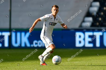 Tom Carroll (14) of Swansea City during the EFL Sky Bet Championship match between Swansea City and Queens Park Rangers at the Liberty Stadium, Swansea