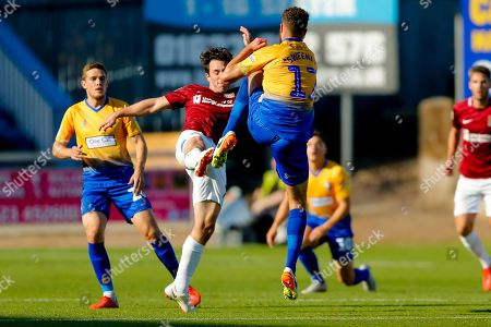 Northampton Town midfielder John-Joe O'Toole (21) and Mansfield Town defender Ryan Sweeney (17), on loan from Stoke City, battle during the EFL Sky Bet League 2 match between Mansfield Town and Northampton Town at the One Call Stadium, Mansfield