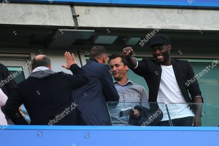 Stock Image of Former Chelsea and Manchester United Coach, Rui Faria, greets Ex Chelsea player, Andily Shevchenko, pre-match as Ex Chelsea player, Michael Essien acknowledges an old friend during Chelsea vs Liverpool, Premier League Football at Stamford Bridge on 29th September 2018