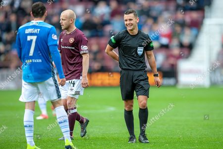 Referee Nick Walsh jokes with Drey Wright (#7) of St Johnstone FC during the Ladbrokes Scottish Premiership match between Heart of Midlothian and St Johnstone at Tynecastle Stadium, Gorgie