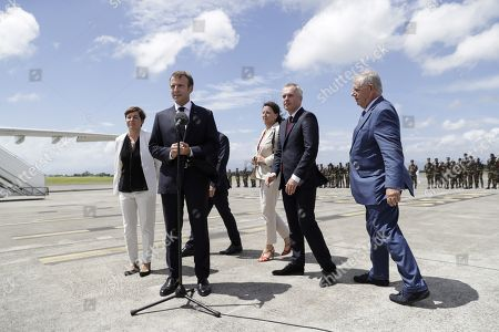 French President Emmanuel Macron (2nd L) arrives with (from L) Overseas Minister Annick Girardin, Minister for Solidarity and Health Agnes Buzyn, Minister for the Ecological and Inclusive Transition Francois de Rugy and Minister for the Territorial Cohesion Jacques Mezard, after landing in Pointe-a-Pitre, Guadeloupe,  28 September 2018. Macron is on a trip in the French West Indies, one year after Hurricane Maria damaged the Island.