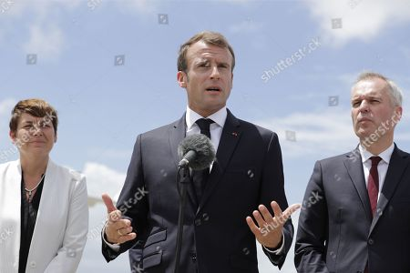 French President Emmanuel Macron (C) speaks after arriving with Overseas Minister Annick Girardin (L) and Minister for the Territorial Cohesion Jacques Mezard in Pointe-a-Pitre, Guadeloupe,  28 September 2018. Macron is on a trip in the French West Indies, one year after Hurricane Maria damaged the Island.