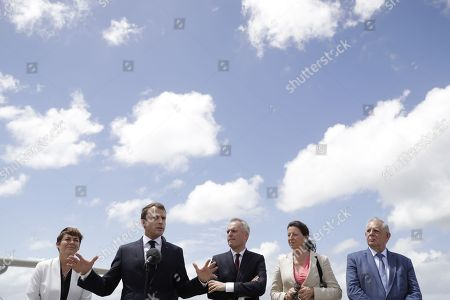 French President Emmanuel Macron (2nd L) speaks after arriving with (from L) Overseas Minister Annick Girardin, Minister for the Ecological and Inclusive Transition Francois de Rugy, Minister for Solidarity and Health Agnes Buzyn and Minister for the Territorial Cohesion Jacques Mezard in Pointe-a-Pitre, Guadeloupe, 28 September 2018. Macron is on a trip in the French West Indies, one year after Hurricane Maria damaged the Island.