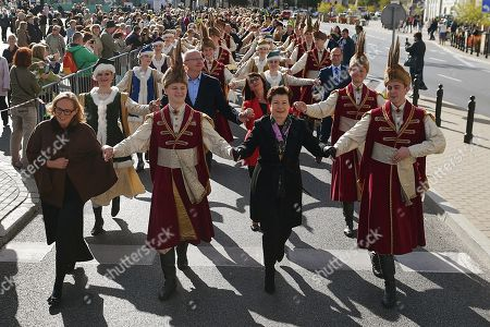 Stock Image of Mayor of Warsaw Hanna Gronkiewicz-Waltz (2-R) and the citizens of Warsaw in traditional Polish outfits take part in 'Warsaw Polonaise Procession' on the streets of Warsaw, Poland, 29 September 2018. Participants danced the most famus Polish dance to mark the centenary of Polish Independence. Poland regained independence on 11 November 1918.