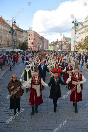 Stock Picture of Mayor of Warsaw Hanna Gronkiewicz-Waltz (2-R) and the citizens of Warsaw in traditional Polish outfits take part in 'Warsaw Polonaise Procession' on the streets of Warsaw, Poland, 29 September 2018. Participants danced the most famus Polish dance to mark the centenary of Polish Independence. Poland regained independence on 11 November 1918.
