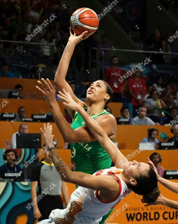 Liz Cambage of the Australia jumps to the basket against Spanish team defenders during the Women's basketball World Cup semi final match between Spain and Australia in Tenerife, Spain
