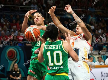 Stock Picture of Liz Cambage of Australia, left, collects the ball against Astou Ndour of Spain during the Women's basketball World Cup semi final match between Spain and Australia in Tenerife, Spain