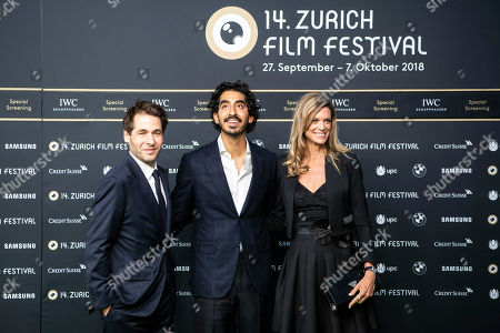 British actor Dev Patel (C) poses with Zurich Film director Karl Spoerri (L) and co-director Nadja Schildknecht (R) on the Green Carpet as he attends the screening of the film 'Lion' at the 14th Zurich Film Festival (ZFF) in Zurich, Switzerland, 29 September 2018. The festival runs from 27 September to 07 October.