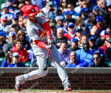 St. Louis Cardinals shortstop Paul DeJong hits an RBI single to drive in St. Louis Cardinals first baseman Matt Carpenter in the fourth inning of their MLB game against the Chicago Cubs at Wrigley Field in Chicago, Illinois, USA, 29 September 2018.