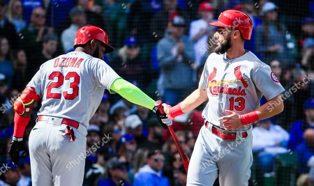 St. Louis Cardinals first baseman Matt Carpenter (R) celebrates with St. Louis Cardinals left fielder Marcell Ozuna (L) as he scores on a base hit by St. Louis Cardinals shortstop Paul DeJong in the foruth inning of their MLB game against the Chicago Cubs at Wrigley Field in Chicago, Illinois, USA, 29 September 2018.