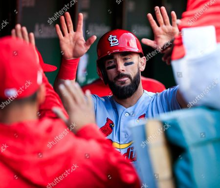 St. Louis Cardinals first baseman Matt Carpenter (R) celebrates with theammates after scoring on a base hit by St. Louis Cardinals shortstop Paul DeJong in the fourth inning of their MLB game against the Chicago Cubs at Wrigley Field in Chicago, Illinois, USA, 29 September 2018.