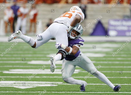 Texas running back Keaontay Ingram (26) is stopped by Kansas State linebacker Adam Davis (26) after a 14-yard gain in the fourth quarter of a college football game in Manhattan, Kan