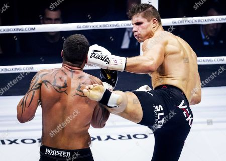 Kickboxers Rico Verhoeven (R) from The Netherlands and Brazilian Guto Inocente in action during their fight in the Johan Cruyff Arena in Amsterdam, The Netherlands on 29 September 2018.