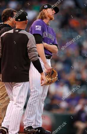 Jon Gray, Scott Gehret, Steve Foster, jon gray. Colorado Rockies starting pitcher Jon Gray, right, is checked on by assistant athletic trainer Scott Gehret, back left, and pitching coach Steve Foster after facing Washington Nationals' Adam Eaton in the first inning of a baseball game, in Denver. Gray remained in the game