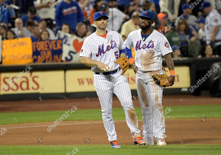 New York Mets third baseman David Wright (5) talks with shortstop Jose Reyes (7) before Wright was taken out of the baseball game during the fifth inning, in New York