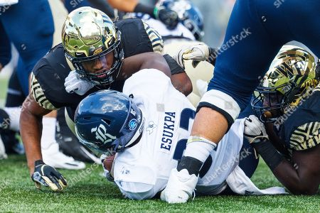 Wake Forest Demon Deacons linebacker DJ Taylor (46) tackles Rice Owls running back Emmanuel Esukpa (33) behind the line in the NCAA matchup between Rice and Wake Forest at BB&T Field in Winston-Salem, NC
