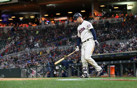 Minnesota Twins' Joe Mauer walks in to bat against the Chicago White Sox in a baseball game, in Minneapolis