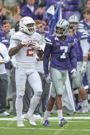 Kansas State Wildcats wide receiver Isaiah Zuber (7) jaws with Texas Longhorns defensive back Kris Boyd (2) in the second half during the NCAA Football Game between the Texas Longhorns and the Kansas State Wildcats at Bill Snyder Family Stadium in Manhattan, Kansas
