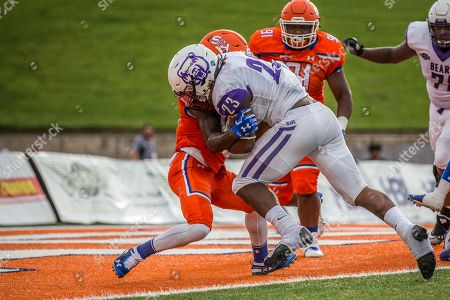 Central Arkansas Bears running back Carlos Blackman (23) powers through the tackle of Sam Houston State Bearkats defensive back Daniel Adams (13) for a 1-yard touchdown run in the 3rd quarter of the NCAA football game between the Central Arkansas Bears and the Sam Houston State Bearkats at Bowers Stadium in Huntsville, Texas. Sam Houston State defeated Central Arkansas 34-31 in overtime. Prentice C