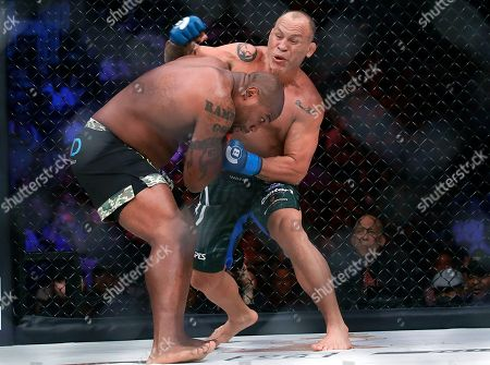 Wanderlei Silva, Quinton Jackson. Wanderlei Silva, rear, punches Quinton Jackson during a heavyweight mixed martial arts bout at Bellator 206 in San Jose, Calif., . Jackson won by technical knockout in the second round