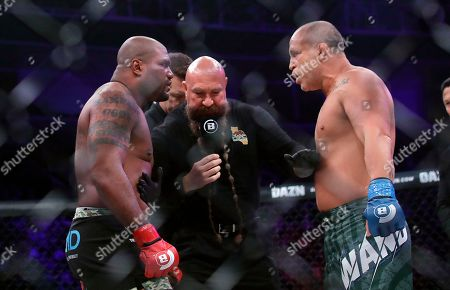 Quinton Jackson, left, faces off with Wanderlei Silva before their heavyweight mixed martial arts fight at Bellator 206 in San Jose, Calif., . At center is referee Mike Beltran