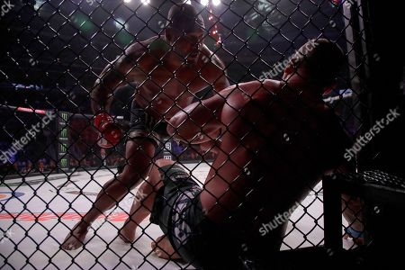 Quinton Jackson, top, punches Wanderlei Silva during a heavyweight mixed martial arts fight at Bellator 206 in San Jose, Calif., . Jackson won by technical knockout in the second round