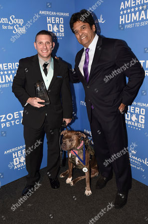 Erik Estrada, Justin Tucker, Roxy. Erik Estrada, right, poses with Justin Tucker and his dog Roxy, winner of the service dog of the year award, at the 2018 American Humane Hero Dog Awards at The Beverly Hilton, in Beverly Hills, Calif