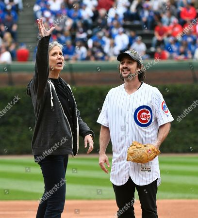 """Stock Image of Amy Morton, Henry Rowengartner. Amy Morton, left, gives some pointers to Henry Rowengartner, as he prepares to throw out a ceremonial first pitch before a baseball game between the St. Louis Cardinals and the Chicago Cubs, in Chicago. They were both actors from the film """"Rookie of the Year"""