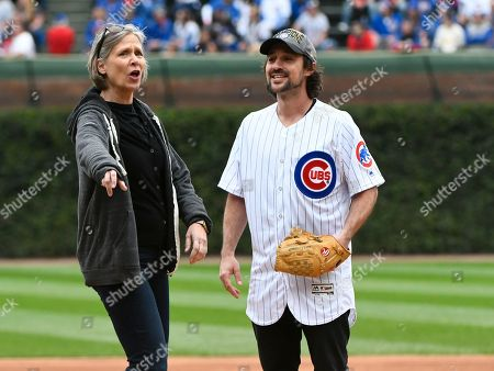 """Amy Morton, Henry Rowengartner. Amy Morton, left, gives some pointers to Henry Rowengartner, as he prepares to throw out a ceremonial first pitch before a baseball game between the St. Louis Cardinals and the Chicago Cubs, in Chicago. They were both actors from the film """"Rookie of the Year"""