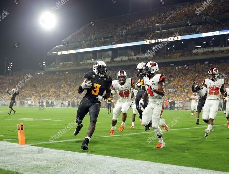 Stock Image of Arizona State running back Eno Benjamin (3) scores a touchdown as Oregon State cornerback Dwayne Williams (4) and linebacker Andrzej Hughes-Murray (49) defend during the first half of an NCAA college football game, in Tempe, Ariz